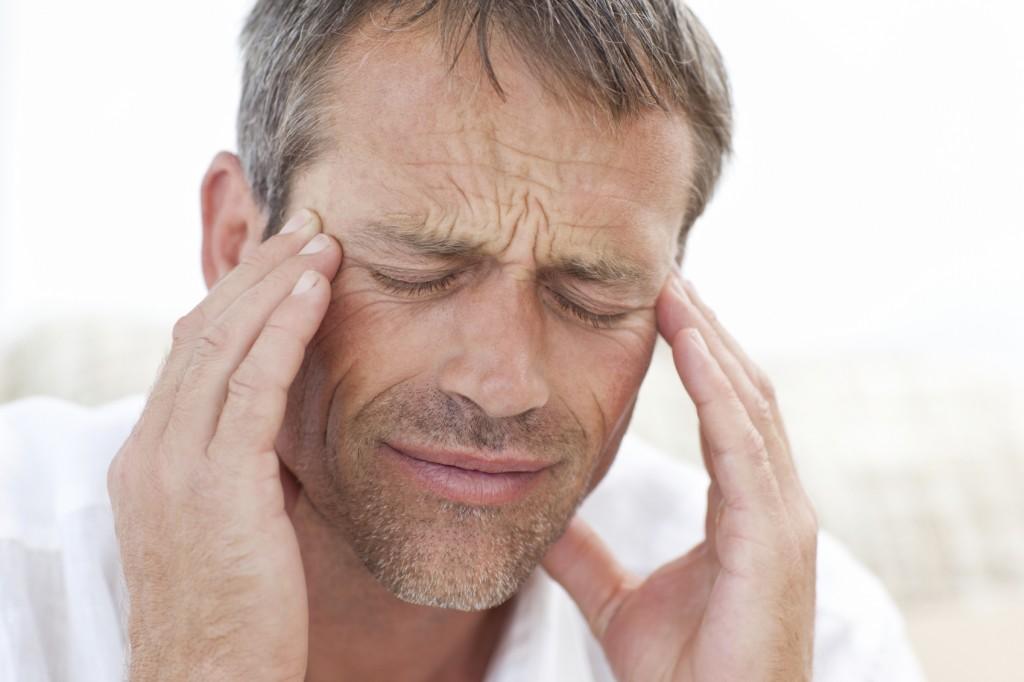 Man having a headache at home